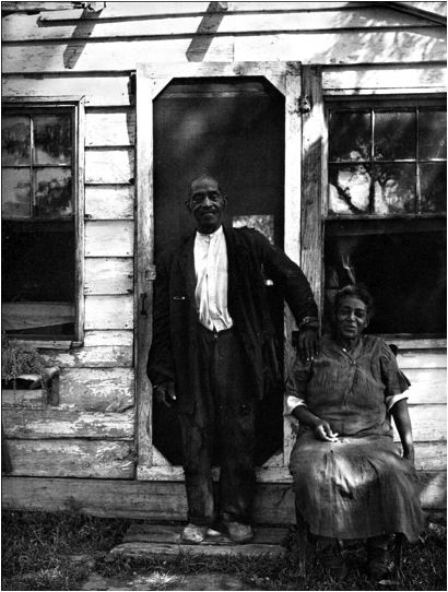 JOHN AND LOUISE DYSON    Mr. Dyson,  nearly 80 when this image was taken in 1940, was born a slave.  Photo: Outside their home in Fordstown, the name of a farm community at Cedar Point, in St. Mary's County, Maryland, evicted by the Federal Government for a Naval installation after the bombing of Pearl Harbor; today the Naval Air Station Patuxent River. — residents were offered very small sums for their land.    (Library of Congress.)