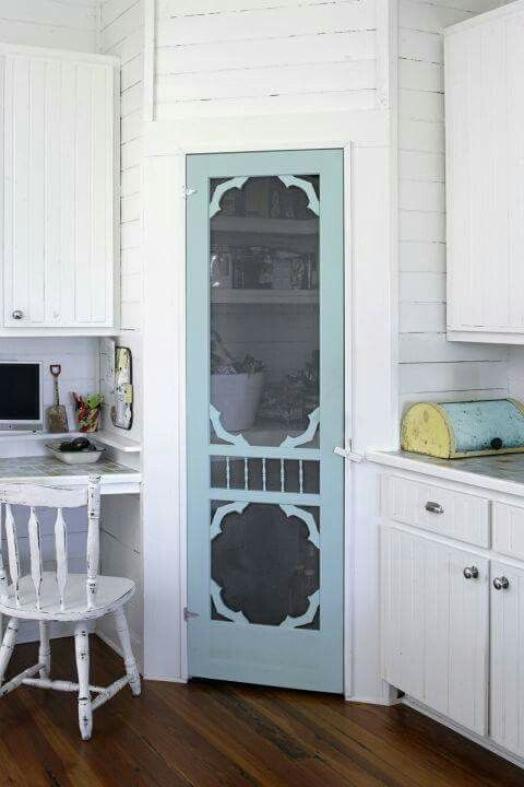 Use a screen door for a pantry door and paint it this aqua blue for cute cottage style....love it!