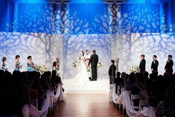 Transform your wedding into a winter wonderland by projecting a wintry scene onto your backdrop.