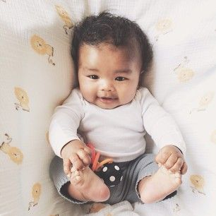 this is a blasian child I believe and it's literally my twin when I was a baby! Yay for Japanese mommies and African American daddies :)