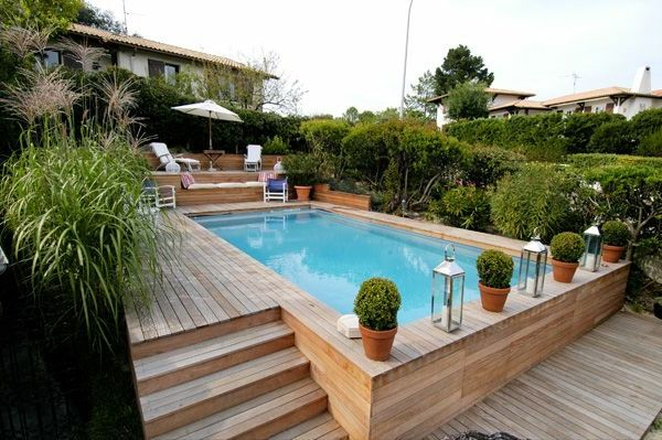 Votre piscine semi enterr e 30 id es cr atives piscine for Piscine bois enterre