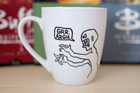 Buffy The Vampire Slayer Joss Whedon Mutant Enemy Mug | 24 TV Show Coffee Mugs That Are Perfect For Both Your Coffee And TV Addiction - i love that little guy at the end!!
