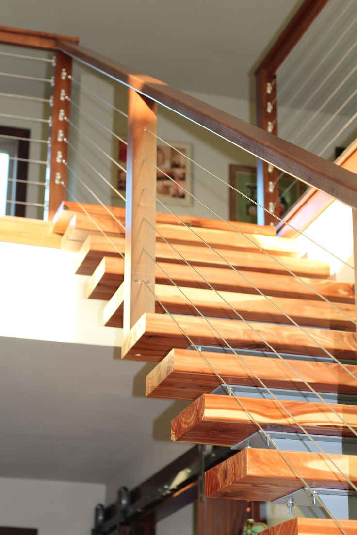 Combine the modern sleek look of cable railing with wood stainless steel or aluminum baluster