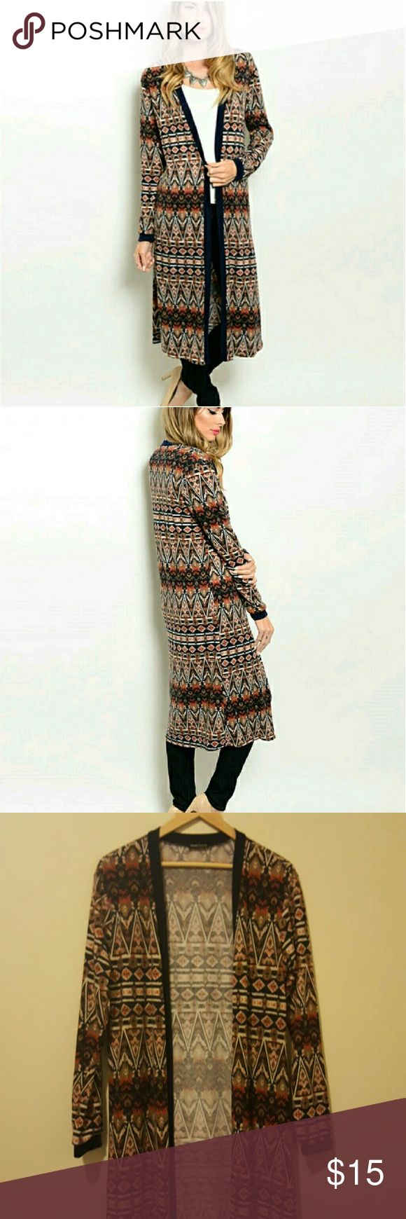 Long Tribal Print Sweater Adorable tribal print sweater. Longer length, perfect with leggings and cute boots. Jella Couture Sweaters Cardigans