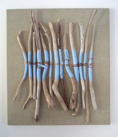 Driftwood Art - spray paint it white & hang it over our bed!