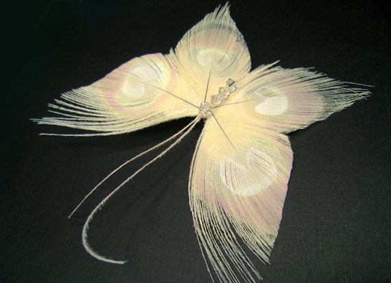 Feather butterfly ivory peacock wedding bridal hair clips headpiece fascinators bride. $46.00, via Etsy.