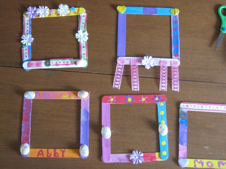 Popsicle stick picture frames kindergarten pinterest for Popsicle picture frame crafts