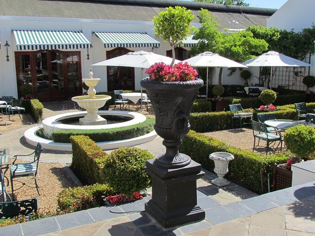 Sit back and relax on the wrought iron seating and soft furnishings at Lanzerac  http://www.lanzerac.co.za/terrace-rb/