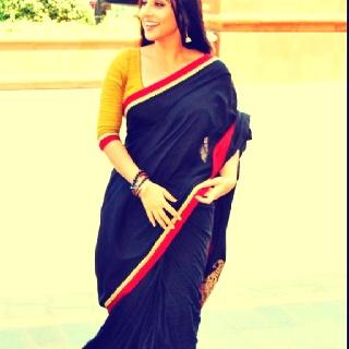 Vidya Balan in a black and yellow Sabyasachi saree