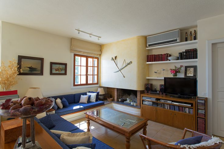 The cosy #living room features a #fireplace and is equipped with tv, dvd-cd player and airconditioning.