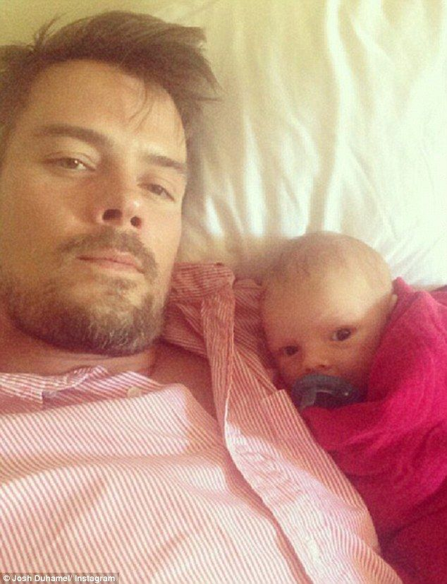 Cute factor: Doting new father Josh Duhamel shared a cuddly snap on Saturday of his newborn son Axl 'catching some football' with him.  I don't usually go for the celeb/baby pix but this is just too damn cute.