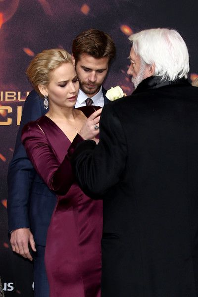 Actors Jennifer Lawrence, Liam Hemsworth and Donald Sutherland attend the world premiere of the film 'The Hunger Games: Mockingjay - Part 2' at CineStar on November 4, 2015 in Berlin, Germany.