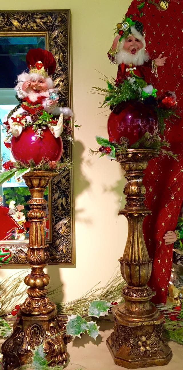 "Cute idea for Mark Roberts fairies: Getting ready for the biggest Christmas tradeshows for retailers next week. A fun way to dress candleholders using my newest Elves with some 6"" glass ball ornaments and a few scraps of pine and berries."