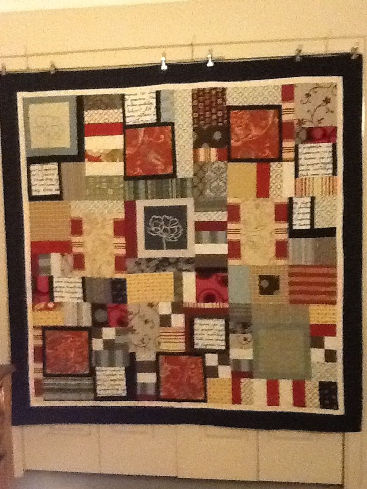My quilt design for a dear friend. Made from an assortment of fabric samples that provide texture and colour.