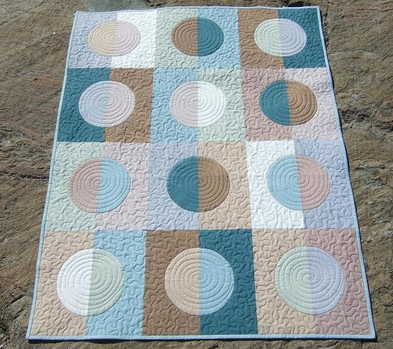 Whisper quilt finished with hand-dyed fabric