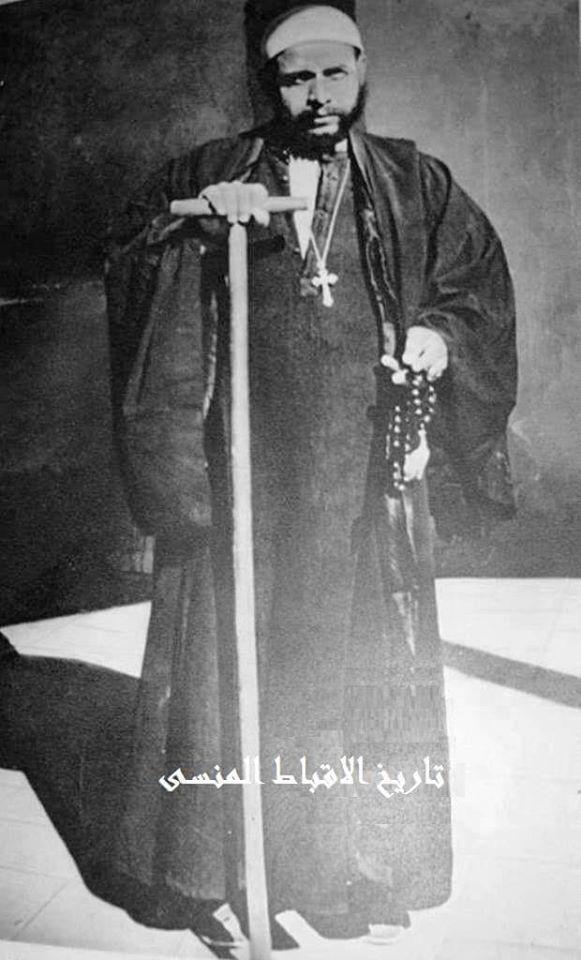 صـورة نـادرة راهب من دير الانبا انطونيوس تعود لبداية القرن التاسع عشر ممسك بعصا الرهبنة واليد الاخرى سبحة الصورة من كتاب Through Lands Of The B Rare Suspender