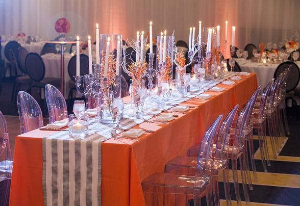 Head table at pink and orange wedding with gray stripes