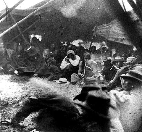 Smoking the peace pipe at Fort Laramie, 1868