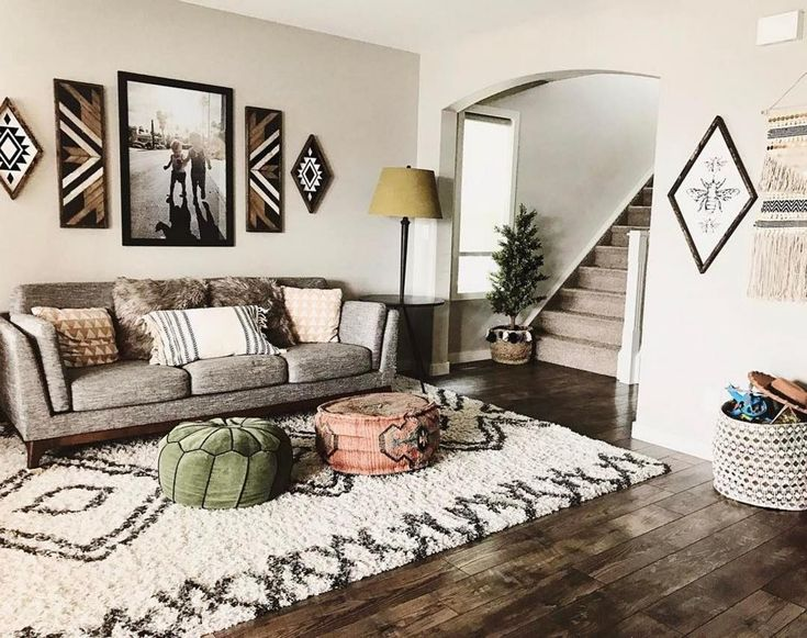 Rolling out the rad area rug in celebration of Kacy's warm, earthy #MyHomeSense style. A simple Moroccan-style area rug looks perfectly at home in her global-inspired living room with chic boho details.