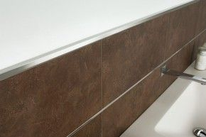 Example of schluter quadec transition from tiled backsplash to wall.  They alternatively have a round transition -- quad is squared.