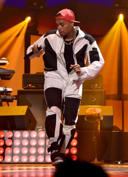 Chris Brown Photos Photos - Recording artist Chris Brown performs onstage during the 2014 iHeartRadio Music Festival at the MGM Grand Garden Arena on September 19, 2014 in Las Vegas, Nevada. - 2014 iHeartRadio Music Festival - Night 1 - Show