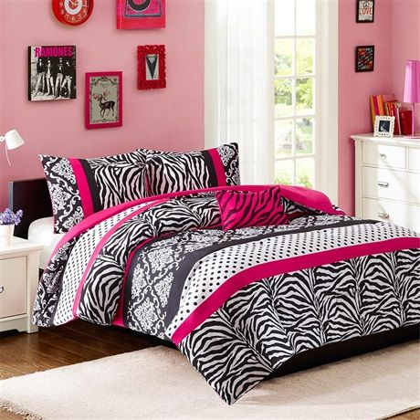 The Mi Zone Reagan Collections offers an edgy yet girly look for your space. The stripes of polka dots, damask print and zebra print create the perfect balance while the hot pink decorative pillow uses black zebra embroidery to pull this look together.