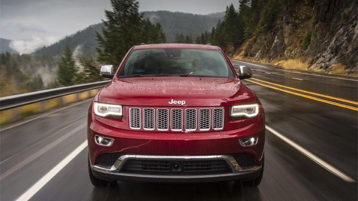 2014 Jeep® Grand Cherokee Summit comes standard with adaptive headlamps with headlamp washers. Shown in Deep Cherry Red Crystal Pearl.
