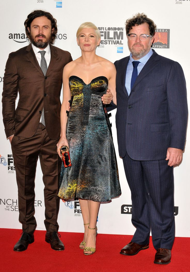 """Casey Affleck (left), Michelle Williams (center), and """"Manchester By The Sea"""" writer/director Kenneth Lonergan (right) arrive on the red carpet at the British Film Institute Film Festival - October 8, 2016."""