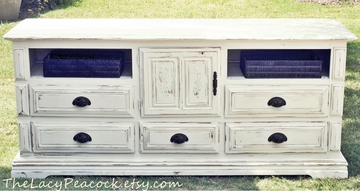 Vintage White Distressed Dresser/ Tv Stand/Buffet/Changing Table with Baskets. $349.00, via Etsy.