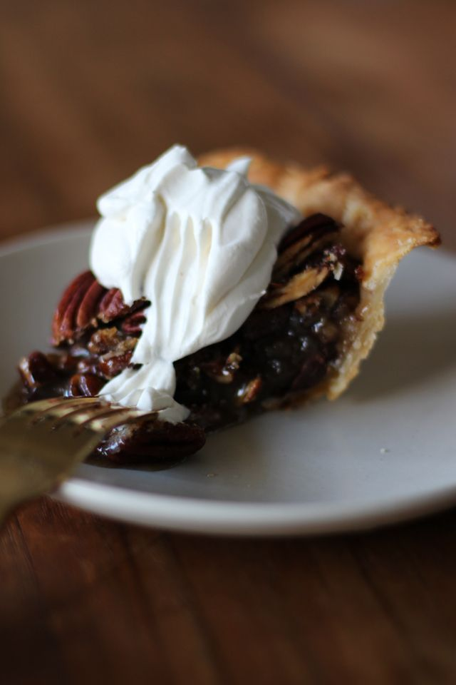 Chocolate pecan pie with bourbon maple whip cream