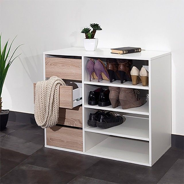 Reynal shoe tidy. This holds up to 12 pairs of shoes, stored neatly in its 4 compartments and 4 drawers. This ultra practical shoe tidy boasts clean lines, plus it's made in France.Reynal shoe tidy:4 compartments with 3 adjustable shelves.4 drawers on runners.Reynal shoe tidy:Melamine particle board, thickness 16mm, with a light oak and/or white finish.Choice of 2 finishes : all white or white with light oak coloured drawer fronts.Untreated MDF base.Size of Reynal shoe tidy:Overal...