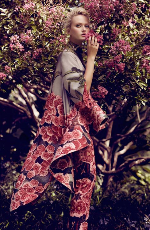 love the florals in this piece... the fashion blends the model beautifully into her backdrop also