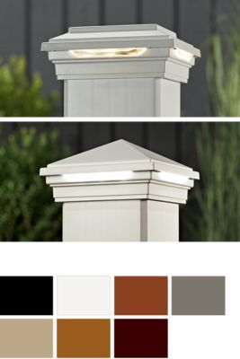 Trex deck post lights in a variety of colors sit discreetly under the post cap to provide your space with a warm glow