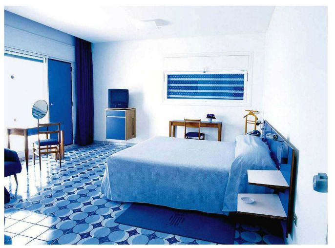 Modern Bedroom In Cornflower And Cobalt Blue With Bright White Walls In The  Past Only