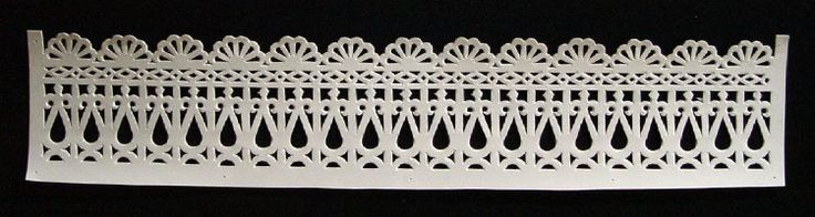 Papercut Lace Batch of altar-ornaments; cut with chisel from white cardboard; design features row of semicircles, row of diamonds, row of tear-drops. Used in Day of the Dead Festival.