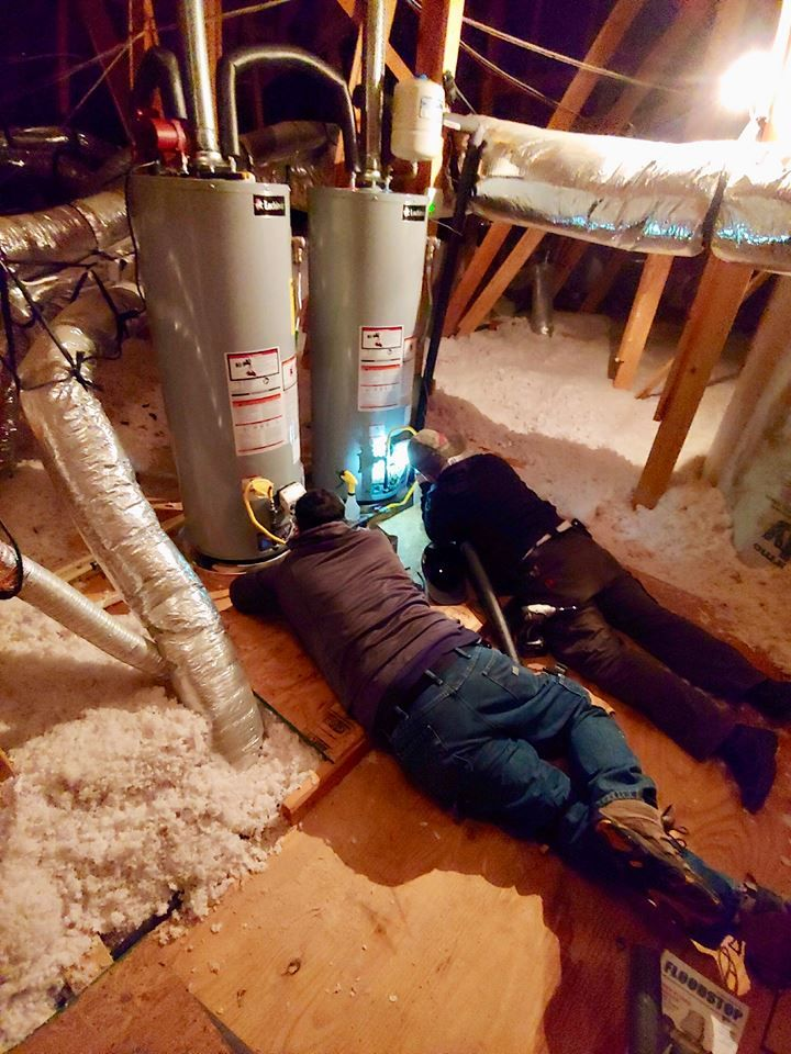 Shad And Steveo Are Lying Down On The Job To Light These Twin Water Heaters In This Huge Attic Plumber Plumbing Waterh Water Heater Heater Gas Water Heater
