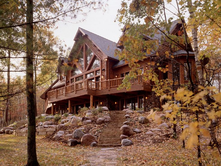 ordinary large log cabin homes #6: The view side showcases the same large gable glass as the entry. The home  offers a walk-out lower level, large deck area, radial sitting area for  master ...