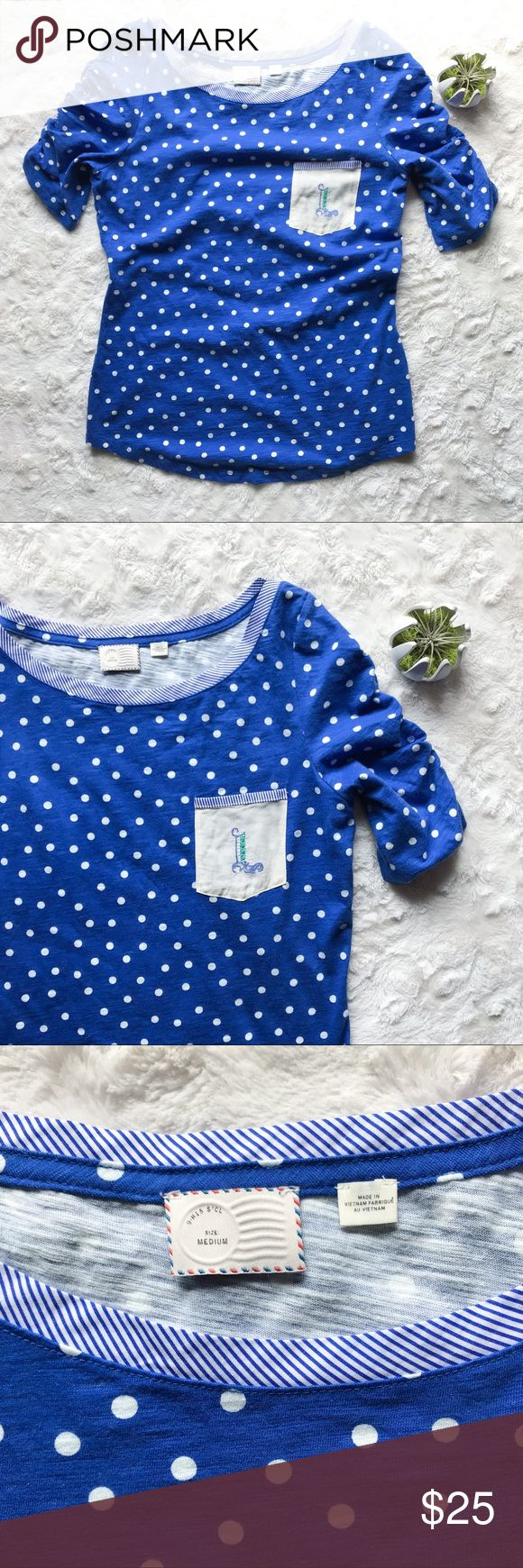 {Anthropologie} 'L' Monogrammed Pocket Tee Blue polka dot tee with lots of details. Ruched sleeves each have a button on the end. The wide collar has a striped blue fabric. The pocket on the tee has a monogrammed 'L'.  Brand: Anthropologie Color: Blue and White Fit & Size: M Condition: preloved, great Fabric Type: Cotton. Machine washable.  O51 Anthropologie Tops Tees - Short Sleeve