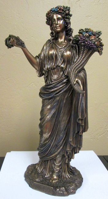 Demeter, goddess of the harvest, who presided over grains and the fertility of the earth.