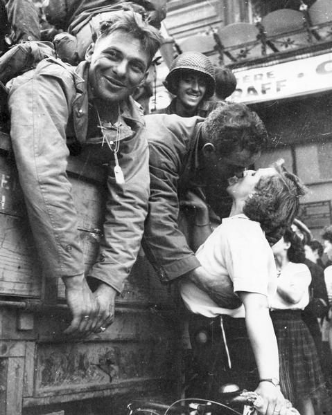 An American soldier receives a kiss in gratitude for the liberation of Paris during World War II. August 25, 1944.