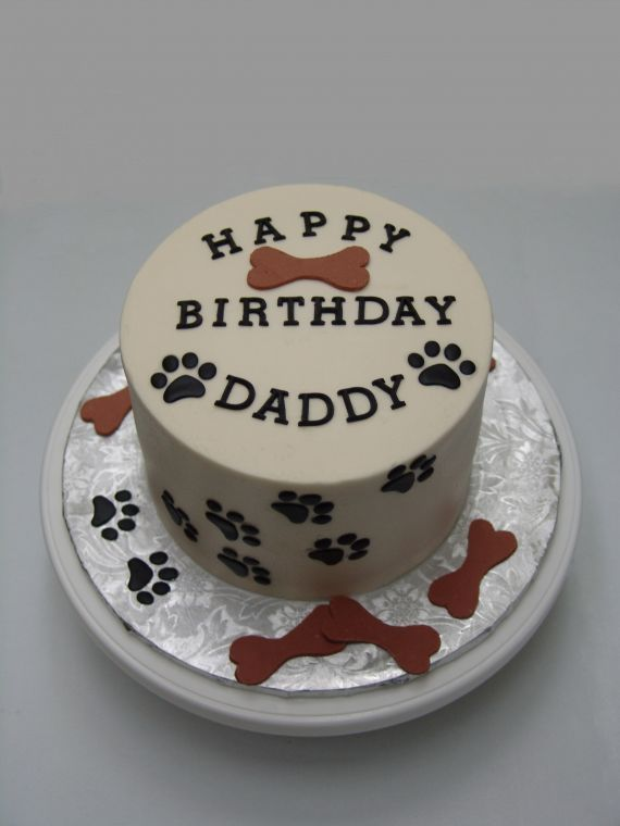 """dog paw print cake - This was 2 6"""" rounds stacked. Covered in buttercream, with fondant accents."""