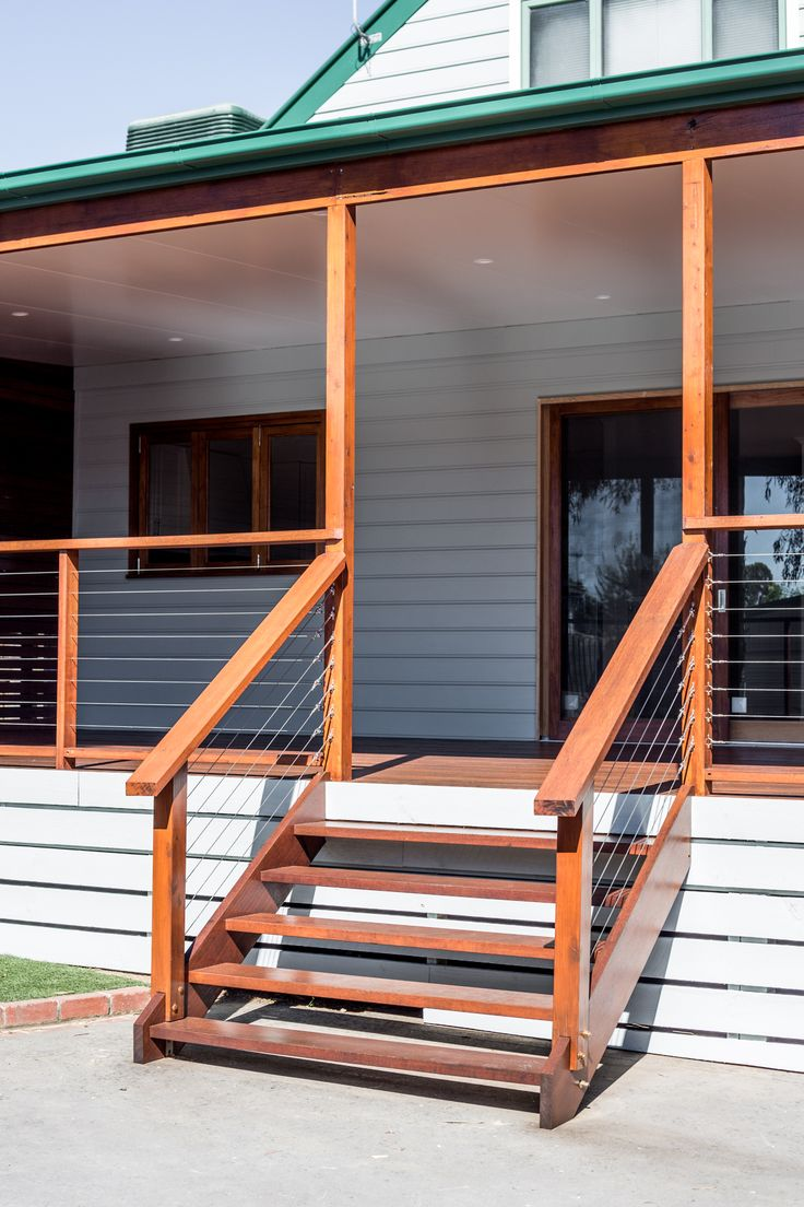 Deck extension in Melbourne featuring Merbau screening, deck and storage bench seating. Also features timber windows and a bifold kitchen servery window. All work by M.J.Harris Group