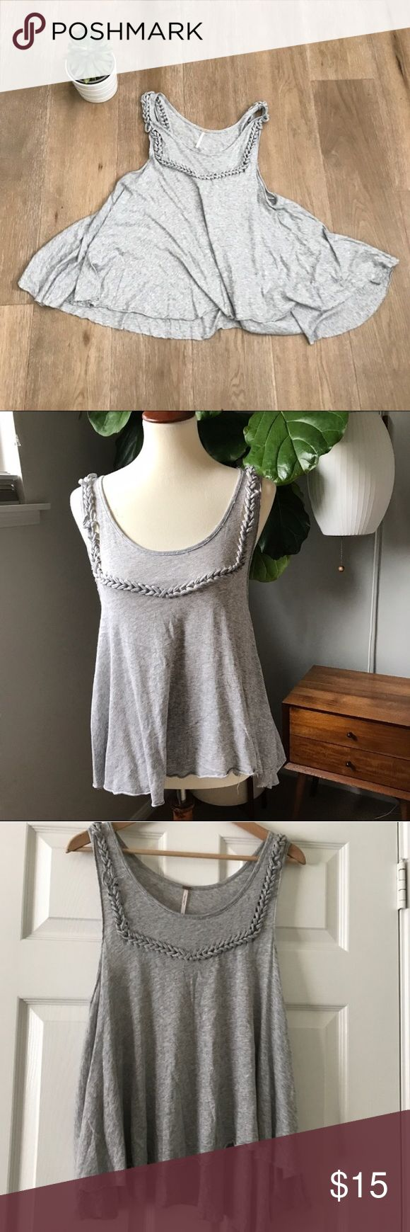 """Free people Flowy tank Size M Free people Flowy tank Size M. Rope detail. Thin and light weight cotton. Super cute with skinny jeans👖.  Ropes are a little pulled and threads lose in some parts but still adorable!  🎈👍😉 Bust 20"""" Length 24"""". Great for upcoming festivals and Coachella!  🌵🌴. Bundle and save 🌸🎈🎈👍 Free People Tops Tank Tops"""