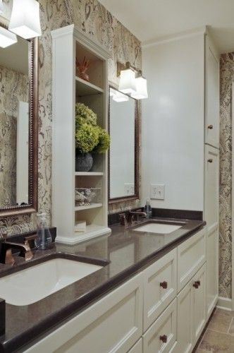 Master Bathroom :: Here's another great example of wasted space turned workhorse. A slender built-in unit rises between the mirrors, keeping toiletries close at hand when getting ready for the day.