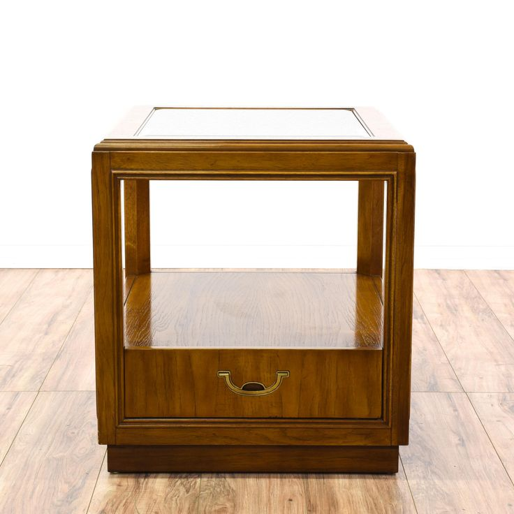 """This """"Drexel"""" end table is featured in a solid wood with a glossy oak finish. This Campaign style side table has a single spacious drawer, glass top, and bottom tier. Perfect for storing magazines! #bohemian #tables #endtable #sandiegovintage #vintagefurniture"""