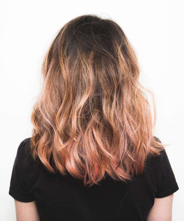 Thinking of coloring your hair pink for spring? This rose gold shade is easy to achieve even on brunettes!