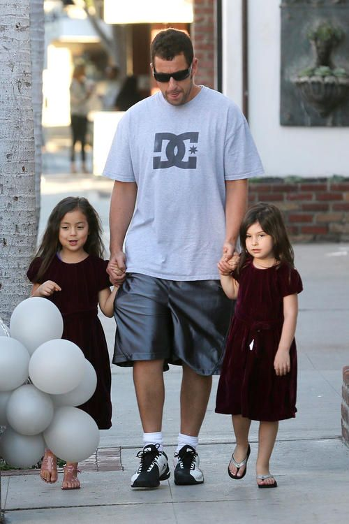 I don't normally post celebrities with their kids but this is a great one of Adam Sandler with his daughters.....reminds me of my husband with our girls.