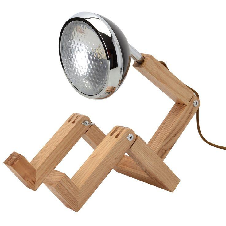 Lampe Bonhomme Noire - La Chaise Longue Cette lampe bonhomme se plie en 4 pour vous ! Elle adoptera la position de votre choix, assise sur une table ou posée sur le bord de l'étagère, pour éclairer votre intérieur. • Lampe originale. • En bois, verre et métal. • Structure articulée. • Lumière orientable. • Fil gainé tissu façon rétro. • Eclairage d'appoint. • Ampoule E27, puissance 40 W max. • Fonctionne sur secteur. • Idée déco originale.  H31x27.5 CM