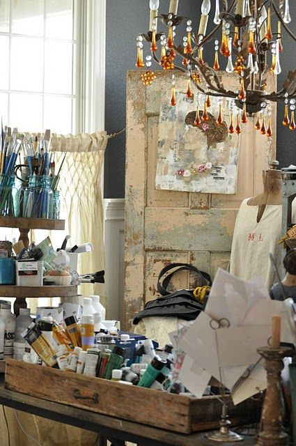 Artist Studio Space... LOVE! The texture of the old wood, the oil paints, the brushes, all given a touch of elegance with the presence of a small chandelier.. It is what I love!
