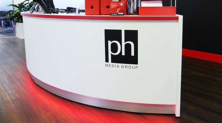 Logo applied to reception desk with red LED lighting. Design, manufacture and installation all available at Space3.co.uk